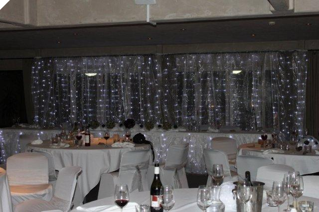 Backdrop created with Organza Fabric and fairylights